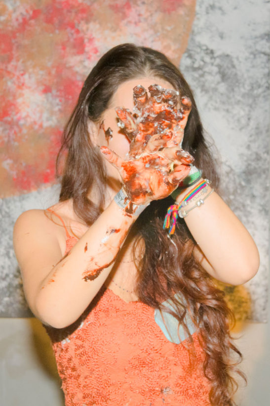 printed photograph of a drunk girl who gets dirty with her birthday cake by making it into a thousand pieces