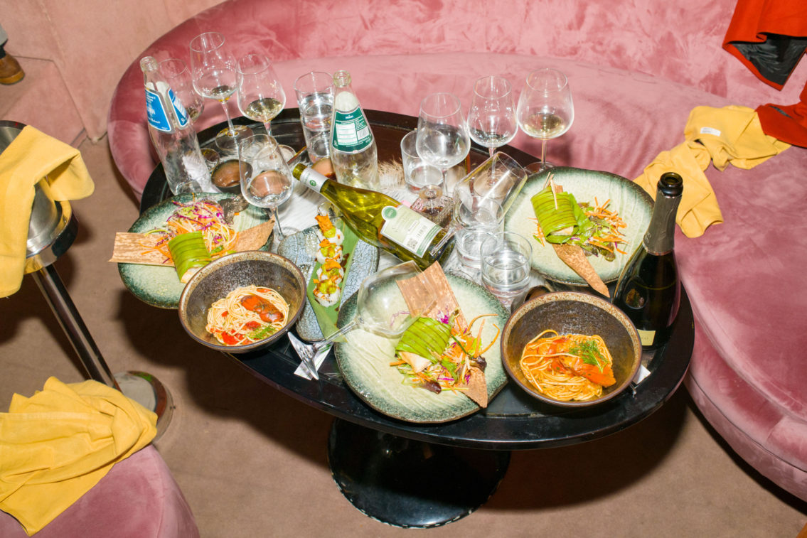 printed photograph of a small table with the remains of a sushi dinner consumed by middle-class people