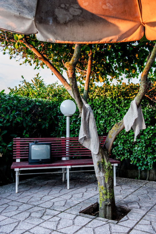 The bench at the seaside house used to put the broken TV and the lemon tree with the cleaning rags on it